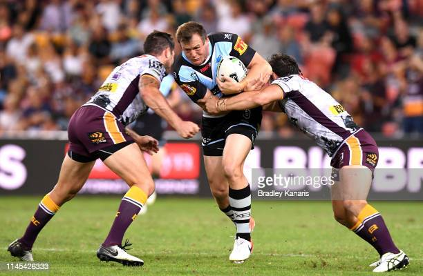 Josh Morris of the Sharks takes on the defence during the round 7 NRL match between the Brisbane Broncos and the Cronulla-Sutherland Sharks at...