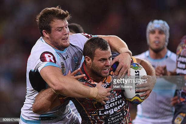 Josh Morris of the World All Stars tackles Wade Graham of the Indigenous All Stars during the NRL match between the Indigenous AllStars and the World...