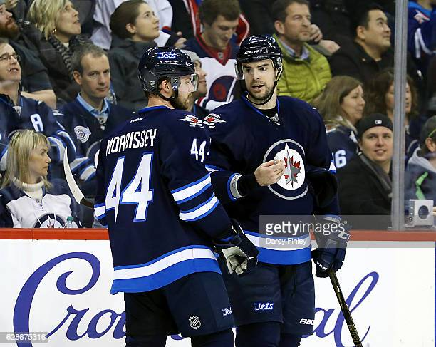 Josh Morrissey and Drew Stafford of the Winnipeg Jets discuss strategy during a third period stoppage in play against the New York Rangers at the MTS...