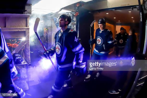 Josh Morrissey and Mason Appleton of the Winnipeg Jets head to the ice prior to puck drop against the Edmonton Oilers at the Bell MTS Place on...