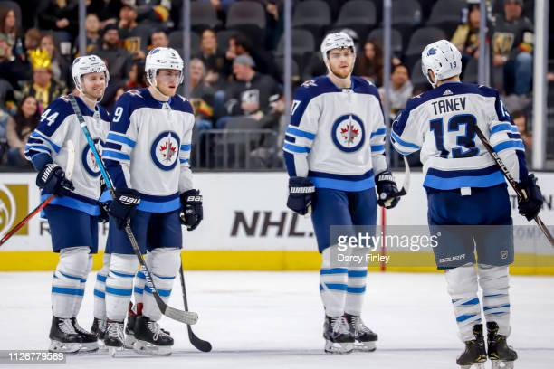 Josh Morrissey Andrew Copp Adam Lowry and Brandon Tanev of the Winnipeg Jets celebrate a third period empty net goal against the Vegas Golden Knights...