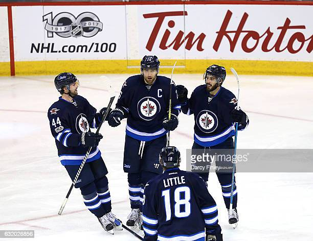 Josh Morrissey Blake Wheeler Mathieu Perreault and Bryan Little of the Winnipeg Jets celebrate a second period goal against the Arizona Coyotes at...