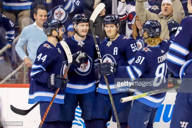 Josh Morrissey Jacob Trouba Mark Scheifele and Kyle Connor of the Winnipeg Jets celebrate a first period goal against the New York Rangers at the...