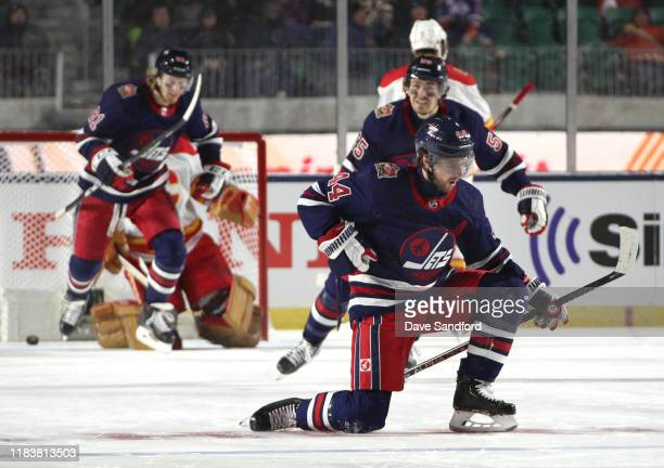 Josh Morrissey of the Winnipeg Jets celebrates after scoring the tying goal in the third period during the 2019 Tim Hortons NHL Heritage Classic at...