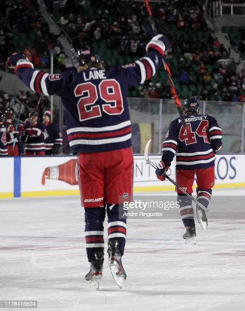 Josh Morrissey of the Winnipeg Jets celebrates with Patrik Laine after scoring a third period goal on the Calgary Flames during the 2019 Tim Hortons...