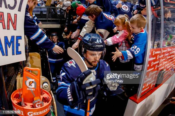 Josh Morrissey of the Winnipeg Jets hits the ice for the start of the pregame warm up prior to NHL action against the Ottawa Senators at the Bell MTS...