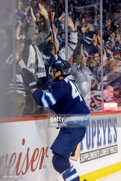 Josh Morrissey of the Winnipeg Jets jumps into the glass as he celebrates his overtime winning goal against the Edmonton Oilers at the Bell MTS Place...