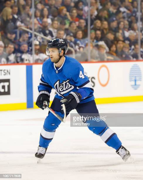 Josh Morrissey of the Winnipeg Jets keeps an eye on the play during second period action against the New Jersey Devils at the Bell MTS Place on...