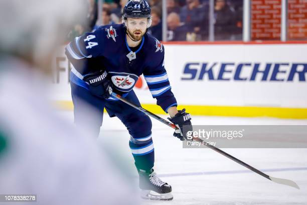 Josh Morrissey of the Winnipeg Jets keeps an eye on the play during first period action against the Dallas Stars at the Bell MTS Place on January 6...