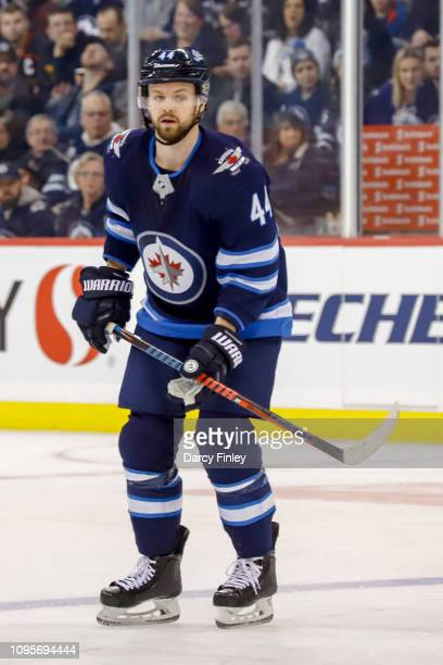 Josh Morrissey of the Winnipeg Jets keeps an eye on the play during first period action against the Anaheim Ducks at the Bell MTS Place on January 13...