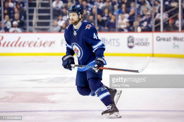 Josh Morrissey of the Winnipeg Jets keeps an eye on the play during second period action against the Ottawa Senators at the Bell MTS Place on...