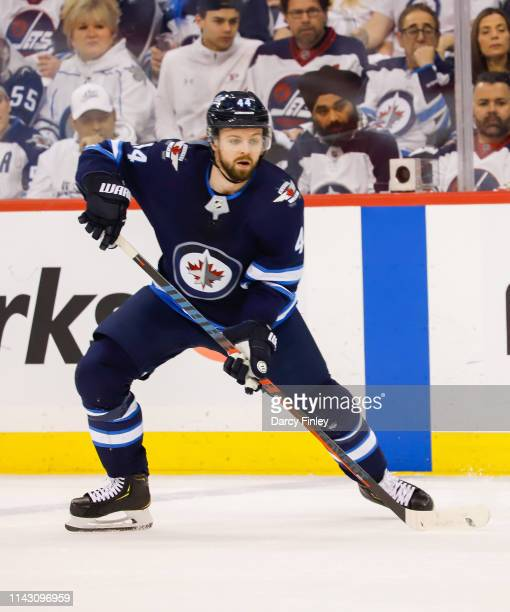 Josh Morrissey of the Winnipeg Jets keeps an eye on the play during third period action against the St Louis Blues in Game Two of the Western...