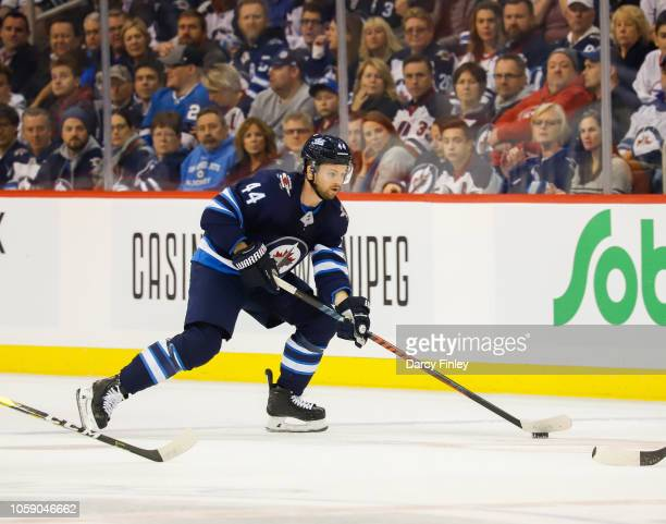 Josh Morrissey of the Winnipeg Jets plays the puck down the ice during first period action against the St Louis Blues at the Bell MTS Place on...