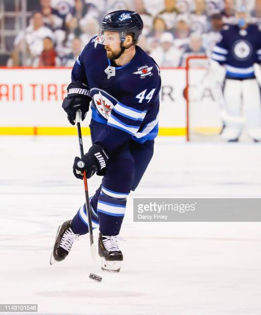 Josh Morrissey of the Winnipeg Jets plays the puck down the ice during second period action against the St Louis Blues in Game Two of the Western...