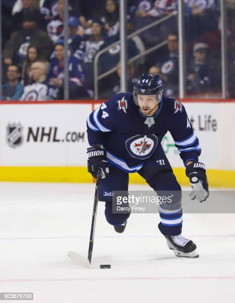 Josh Morrissey of the Winnipeg Jets plays the puck down the ice during second period action against the Los Angeles Kings at the Bell MTS Place on...