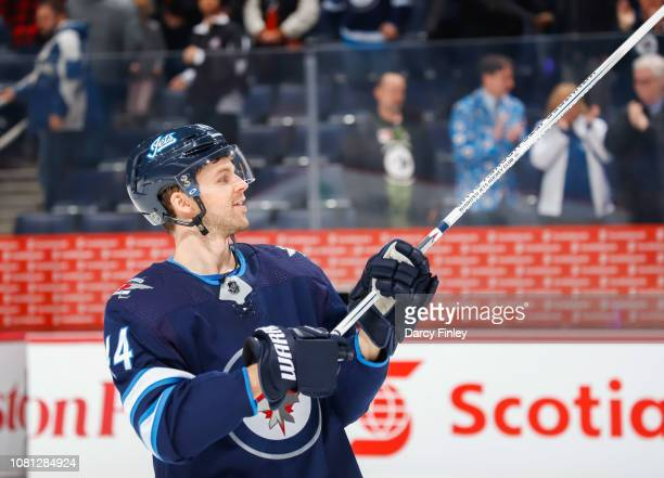 Josh Morrissey of the Winnipeg Jets salutes the fans after being named the second star of the game following a 71 victory over the Philadelphia...
