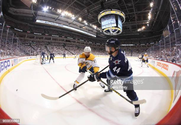 Josh Morrissey of the Winnipeg Jets shoots the puck past Nick Bonino of the Nashville Predators during third period action in Game Six of the Western...