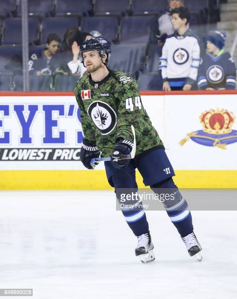 Josh Morrissey takes part in the pregame warm up wearing a special military themed jersey for Canadian Armed Forces Appreciation Night prior to NHL...