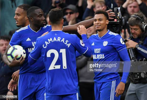 Josh Murphy of Cardiff City celebrates with teammates after scoring his team's first goal during the Premier League match between Cardiff City and...