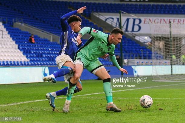 Josh Murphy of Cardiff City is fouled by Nathan Thomas of Carlisle United during the FA Cup third round match between Cardiff City and Carlisle...
