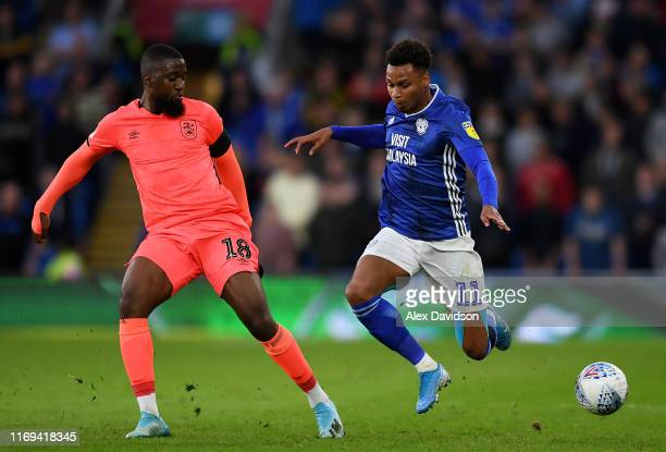 Josh Murphy of Cardiff City is tackled by Isaac Mbenza of Huddersfield during the Sky Bet Championship match between Cardiff City and Swansea City at...