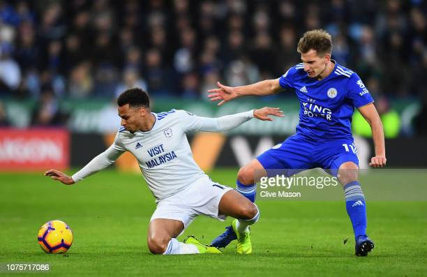 Josh Murphy of Cardiff City is tackled by Marc Albrighton of Leicester City during the Premier League match between Leicester City and Cardiff City...