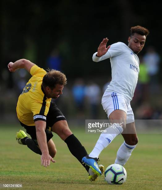 Josh Murphy of Cardiff City is tackled by Max Gilbert of Bodmin Town during the PreSeason Friendly match between Bodmin Town and Cardiff City at...