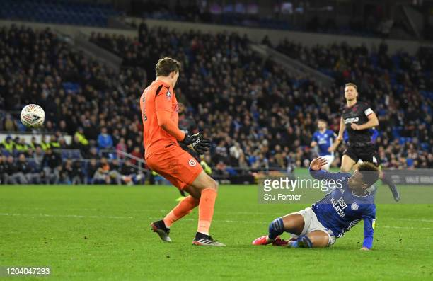 Josh Murphy of Cardiff City scores his team's third goal past Sam Walker of Reading FC during the FA Cup Fourth Round Replay match between Cardiff...
