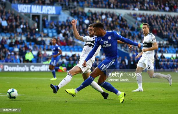 Josh Murphy of Cardiff City takes a shot at goal while under pressure from Calum Chambers of Fulham during the Premier League match between Cardiff...