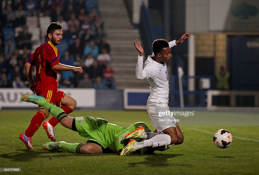 Josh Murphy of England is bought down by Razvan Began of Romania in the penalty area during the U20 International friendly match between England and Romania on September 5, 2014 in Telford, England.
