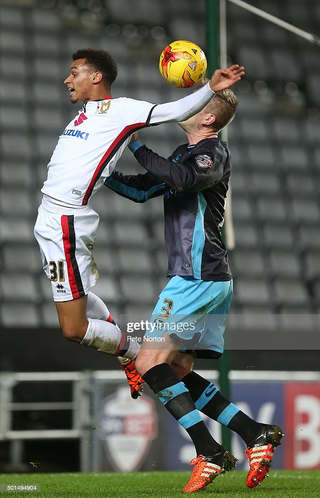 Josh Murphy of Milton Keynes Dons contests the ball with Michael Turner of Sheffield Wednesday during the Sky Bet Championship match between Milton Keynes Dons and Sheffield Wednesday at stadium:mk on December 15, 2015 in Milton Keynes, United Kingdom.