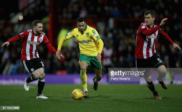 Josh Murphy of Norwich City is closed down by Alan Judge of Brentford and Andreas Bjelland of Brentford during the Sky Bet Championship match between...