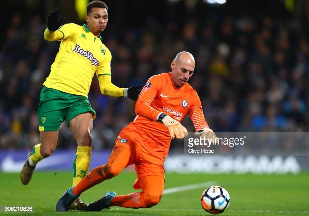Josh Murphy of Norwich City puts pressure on goalkeeper Willy Caballero of Chelsea during The Emirates FA Cup Third Round Replay between Chelsea and...