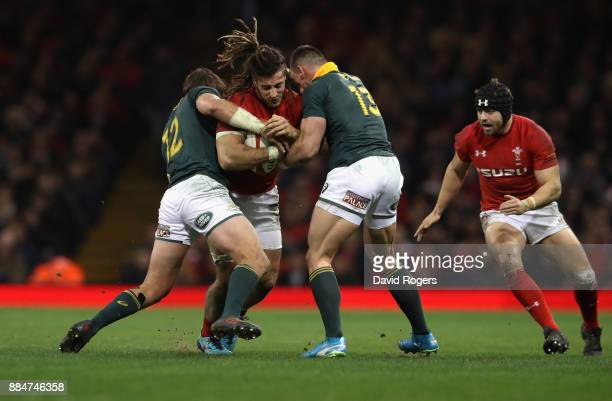 Josh Navidi of Wales is tackled by Francois Venter and Jesse Kriel during the rugby union international match between Wales and South Africa at the...