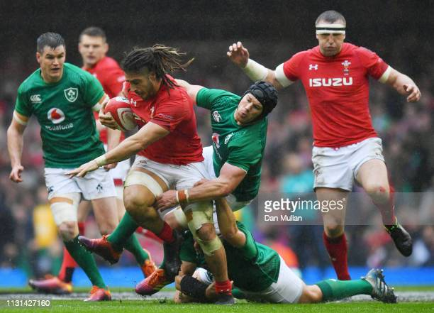 Josh Navidi of Wales is tackled by Rory Best and Sean O'Brien of Ireland during the Guiness Six Nations match between Wales and Ireland at the...