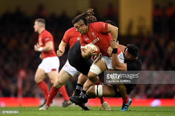 Josh Navidi of Wales is tackled during the International match between Wales and New Zealand at Principality Stadium on November 25 2017 in Cardiff...