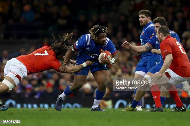 Josh Navidi of Wales tackles Mathieu Bastareaud of France during the NatWest Six Nations match between Wales and France at Principality Stadium on...
