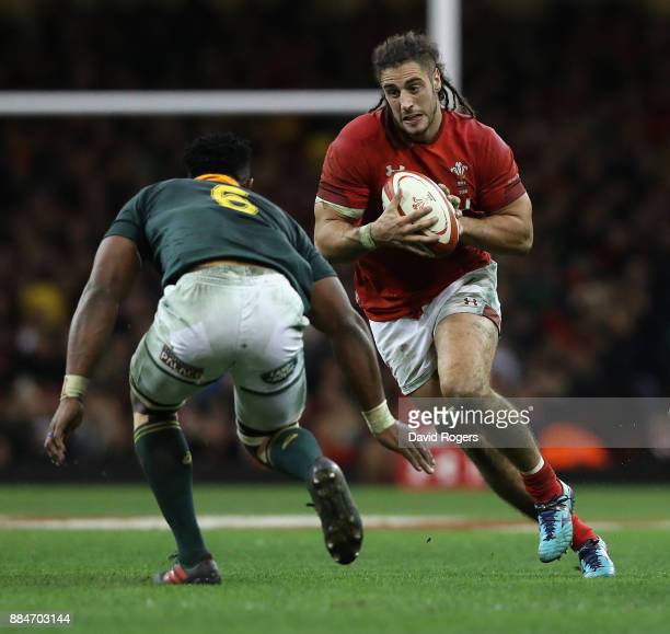 Josh Navidi of Wales takes on Siya Kolisi during the rugby union international match between Wales and South Africa at the Principality Stadium on...