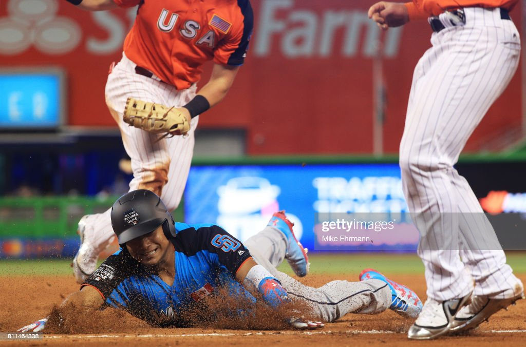 Josh Naylor #14 of the San Diego Padres and the World Team is tagged out by Kyle Tucker #30 of the Houston Astros and the U.S. Team in the fifth inning during the SiriusXM All-Star Futures Game at Marlins Park on July 9, 2017 in Miami, Florida.