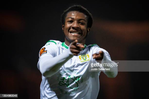 Josh Neufville of Yeovil Town celebrates scoring the fourth Yeovil goal at The Hive on March 02, 2021 in Barnet, England. Sporting stadiums around...
