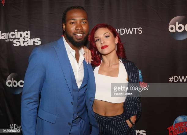 Josh Norman and Sharna Burgess pose as the Dancing with the Stars Athletes Season 26 cast visits Planet Hollywood Times Square on April 13 2018 in...