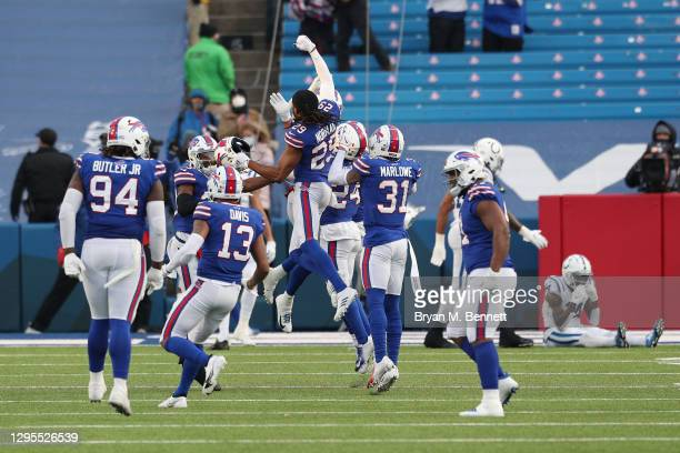 Josh Norman of the Buffalo Bills celebrates with teammates after winning the AFC Wild Card playoff game against the Indianapolis Colts at Bills...