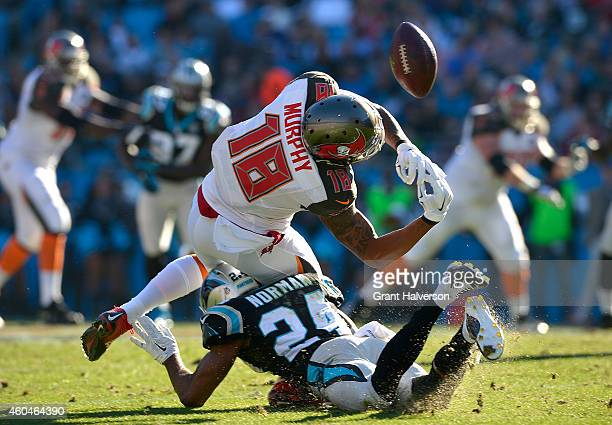 Josh Norman of the Carolina Panthers breaks up a pass intended for Louis Murphy of the Tampa Bay Buccaneers during their game at Bank of America...
