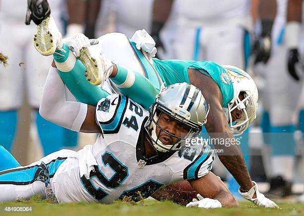 Josh Norman of the Carolina Panthers stops Jarvis Landry of the Miami Dolphins short of a first down during their preseason NFL game at Bank of...
