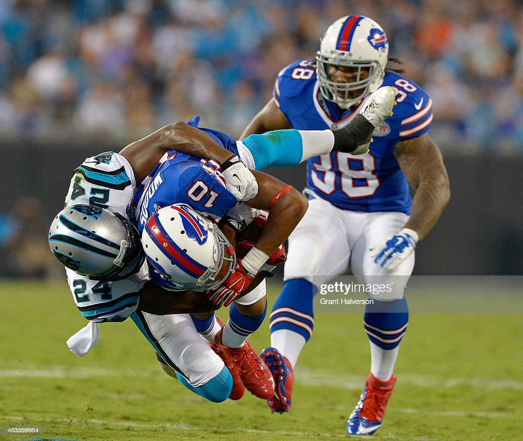 Josh Norman #24 of the Carolina Panthers tackles Robert Woods #10 of the Buffalo Bills during their game at Bank of America Stadium on August 8, 2014 in Charlotte, North Carolina.