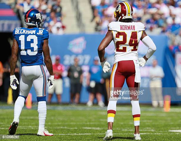 Josh Norman of the Washington Redskins and Odell Beckham of the New York Giants look on at MetLife Stadium on September 25 2016 in East Rutherford...