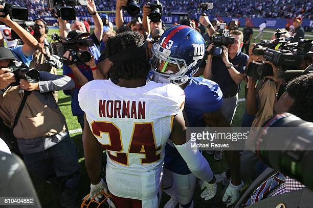 Josh Norman of the Washington Redskins and Odell Beckham of the New York Giants shake hands following the game at MetLife Stadium on September 25...