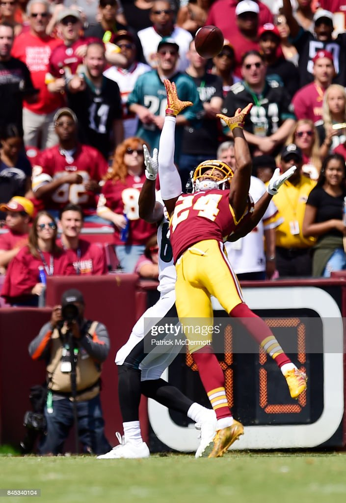 Josh Norman #24 of the Washington Redskins fights for a cactch against the Philadelphia Eagles in the second quarter at FedExField on September 10, 2017 in Landover, Maryland.