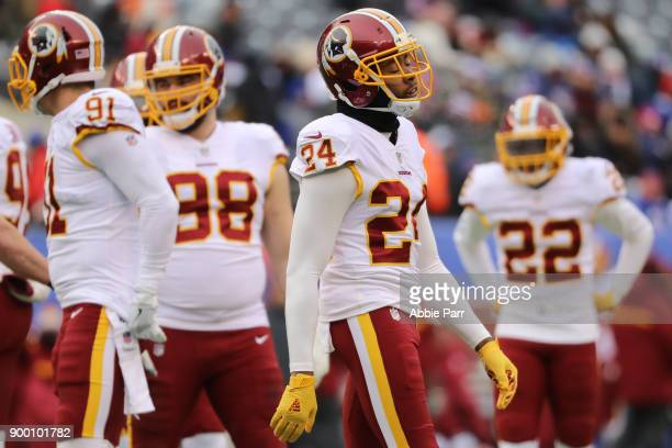 Josh Norman of the Washington Redskins reacts against the New York Giants in the second quarter during their game at MetLife Stadium on December 31...