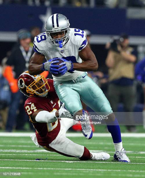 Josh Norman of the Washington Redskins tries to stop Amari Cooper of the Dallas Cowboys in the first quarter of a football game at ATT Stadium on...
